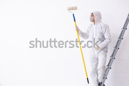 Chemist working with poisonous substances isolated on white back Stock photo © Elnur