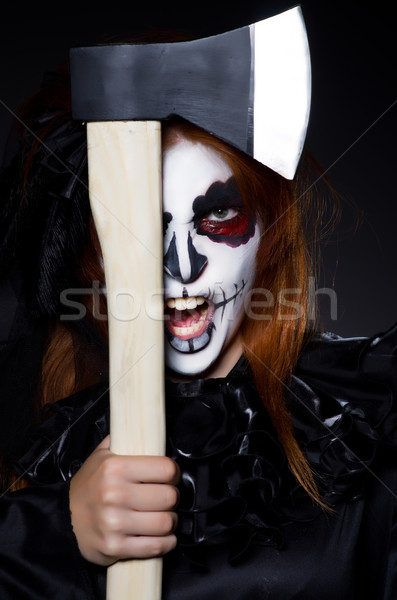 Woman monster with axe in dark room Stock photo © Elnur
