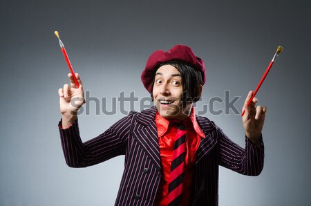 Funny prisoner with knuckles isolated on gray Stock photo © Elnur