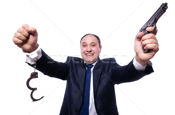 Man with gun and handcuffs on white Stock photo © Elnur