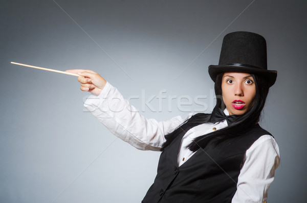 Woman magician in funny concept Stock photo © Elnur