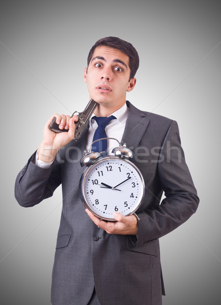Man with gun and clock on white Stock photo © Elnur