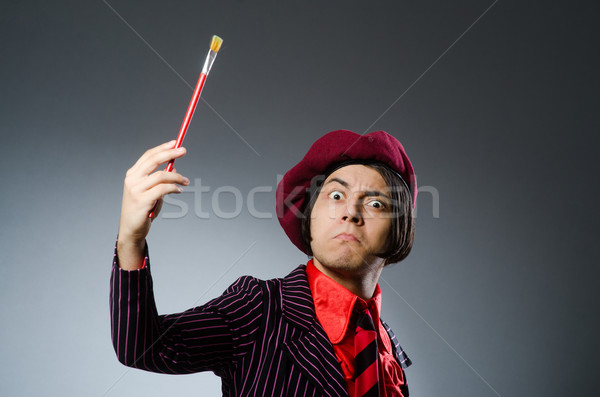 Funny artist with his artwork Stock photo © Elnur