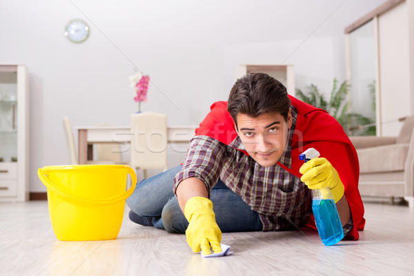 Super hero husband cleaning floor at home Stock photo © Elnur