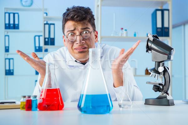 Funny mad chemik pracy laboratorium człowiek Zdjęcia stock © Elnur