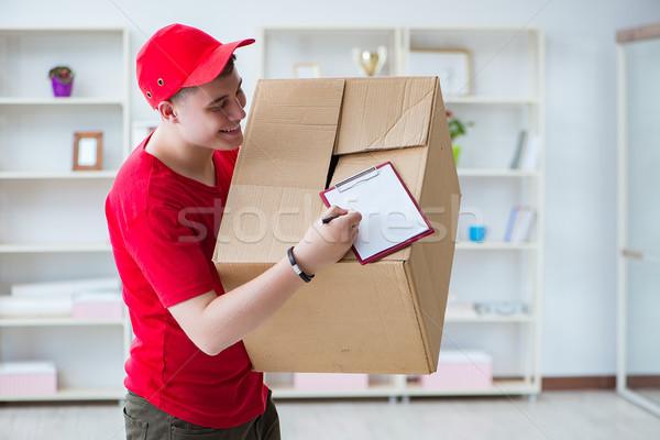 Post man delivering a parcel package Stock photo © Elnur