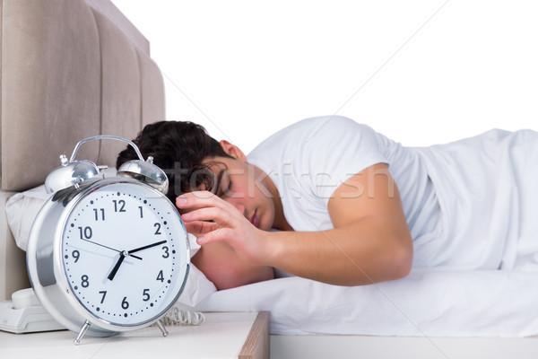 Man bed lijden slapeloosheid klok gezondheid Stockfoto © Elnur