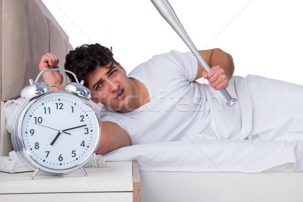 Hombre cama sufrimiento insomnio reloj béisbol Foto stock © Elnur