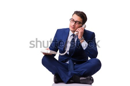 Businessman sitting on the floor isolated on white Stock photo © Elnur
