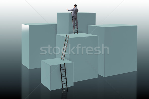 Businessman climbing blocks in challenge business concept Stock photo © Elnur