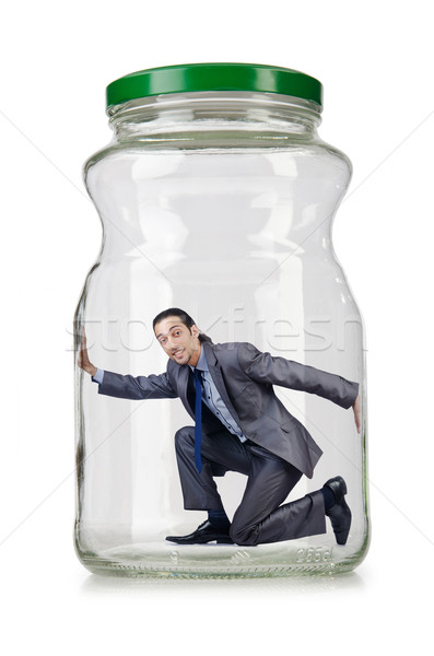 Young businessman in glass jar Stock photo © Elnur