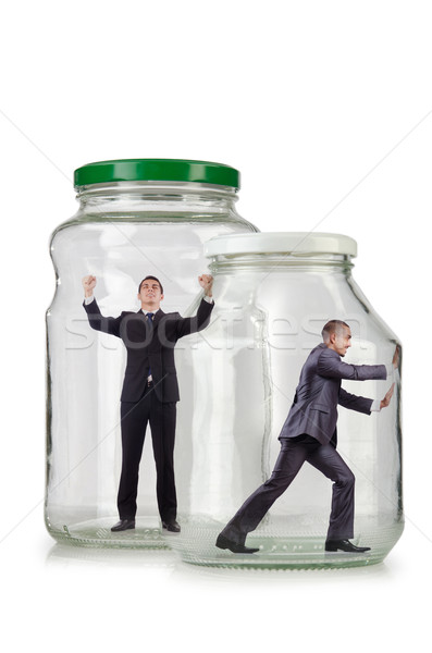 Stock photo: Young businessman in glass jar