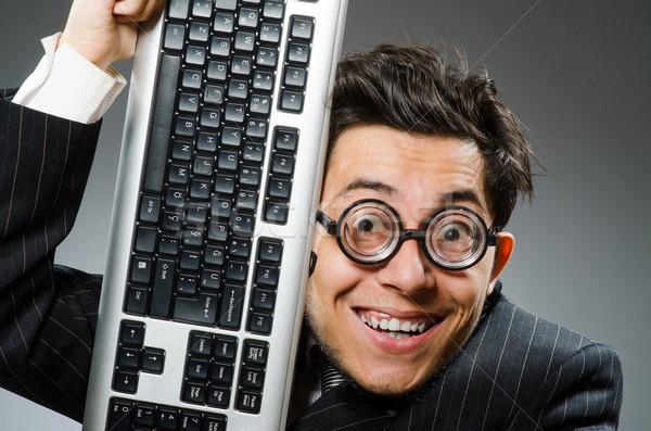 Computer geek with computer keyboard Stock photo © Elnur