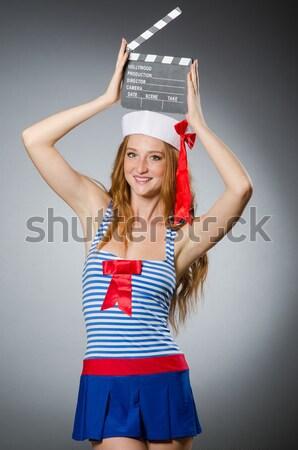 Female sailor against grey background Stock photo © Elnur