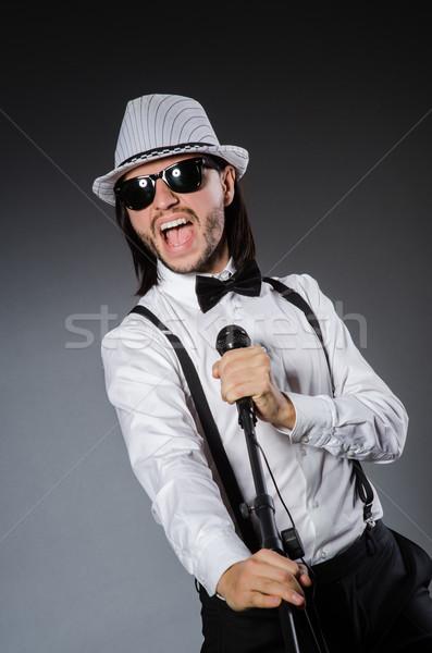 Funny piosenkarka mikrofon koncertu człowiek włosy Zdjęcia stock © Elnur