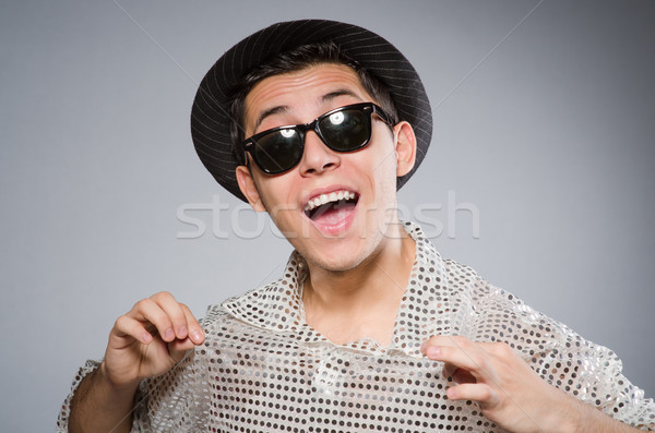 Young man in silver shirt and hat isolated on white Stock photo © Elnur