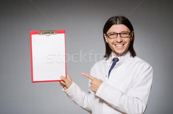 Férfi orvos napló szürke iroda háttér kórház Stock fotó © Elnur