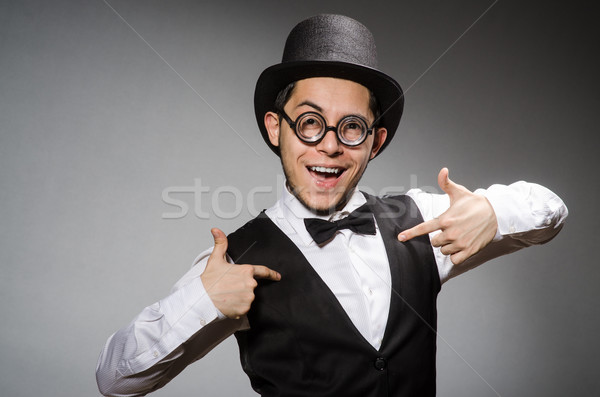 Young man in classical black vest and hat against gray Stock photo © Elnur