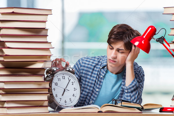 The student with lots of books preparing for exams Stock photo © Elnur