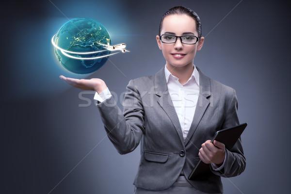 деловая женщина Воздушные путешествия бизнеса женщину рук Мир Сток-фото © Elnur