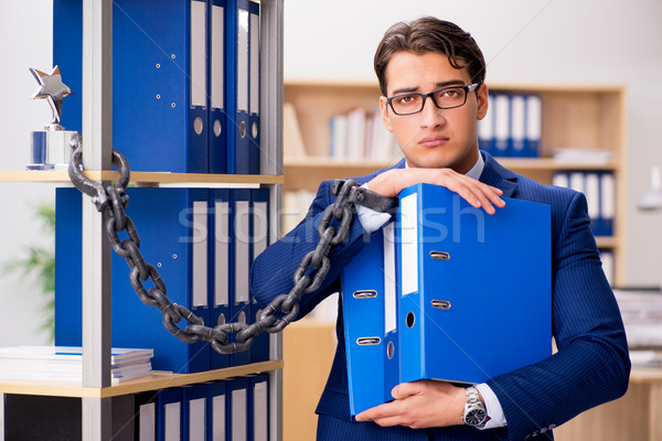 Handsome businessman chained to the office shelf Stock photo © Elnur