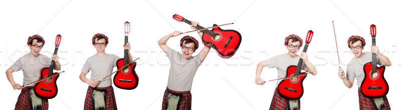 The funny scotsman with musical instrument isolated on white Stock photo © Elnur