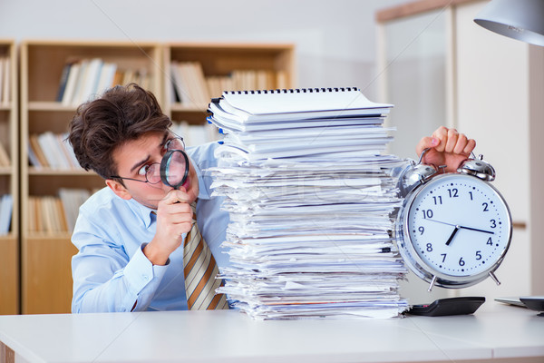 Stock photo: Mad auditor looking for errors in the report