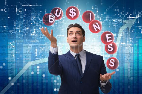 Empresário malabarismo negócio dinheiro homem Foto stock © Elnur