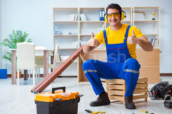 Repairman carpenter working with wooden plank planks Stock photo © Elnur