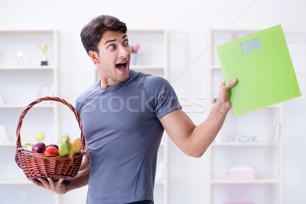 Man promoting the benefits of healthy eating and doing sports Stock photo © Elnur