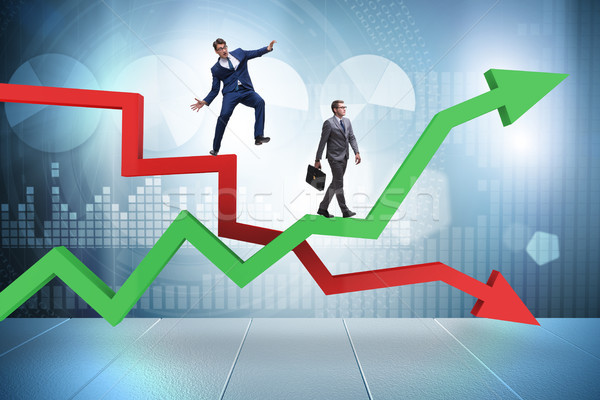 Opposite growth and decliine charts with businessman Stock photo © Elnur