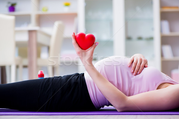 Pregnant woman exercising in anticipation of child birth Stock photo © Elnur