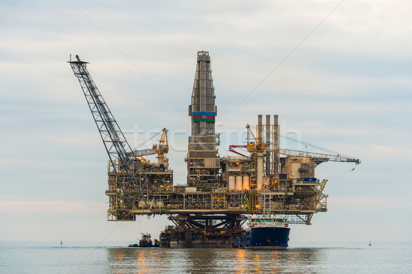 Oil rig platform in the calm sea Stock photo © Elnur
