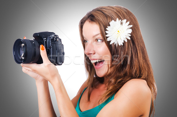 Attractive female photographer on white Stock photo © Elnur