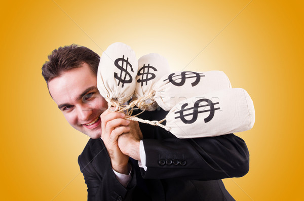Man with money sacks against the gradient Stock photo © Elnur