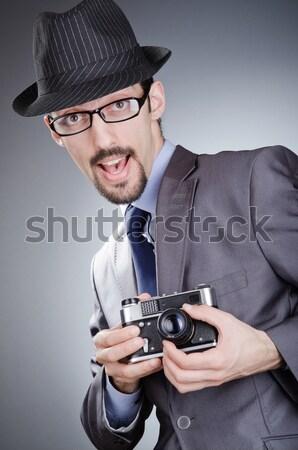 молодым человеком элегантный костюм пистолет серый Сток-фото © Elnur