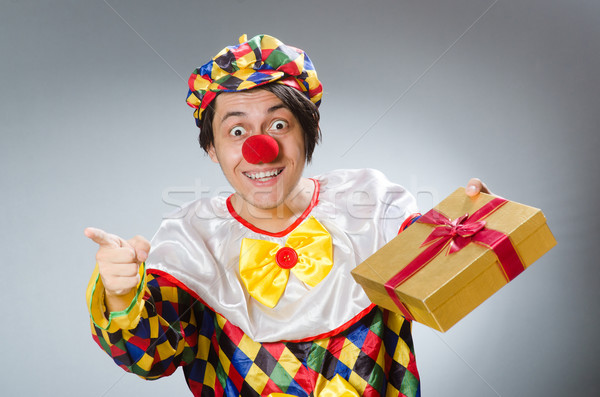 Clown with giftbox in funny concept Stock photo © Elnur