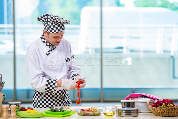 Male cook preparing food in the kitchen Stock photo © Elnur