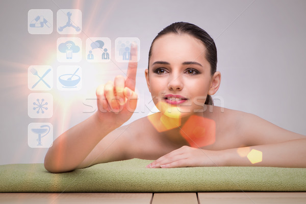 Stock photo: Woman in spa pressing buttons
