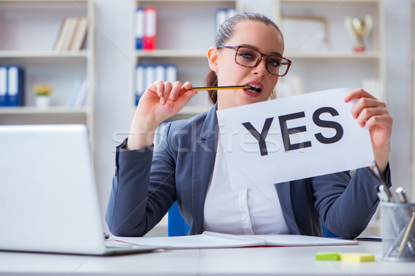 Businesswoman with yes message in office Stock photo © Elnur