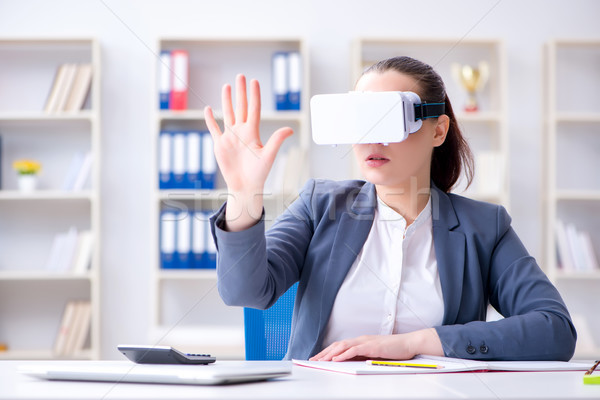 Businesswoman with virtual reality glasses in office Stock photo © Elnur