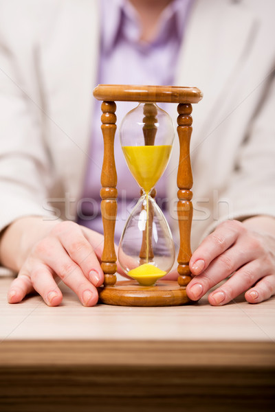 Hourglasses in business concept in time concept Stock photo © Elnur