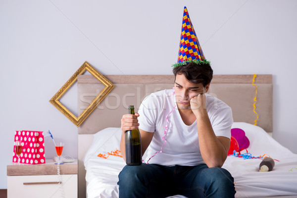 Man at home after heavy partying Stock photo © Elnur