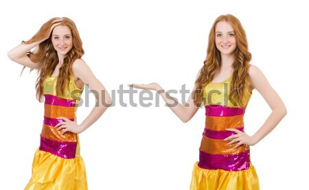 Young beautiful girl in red dress pointing isolated on white Stock photo © Elnur
