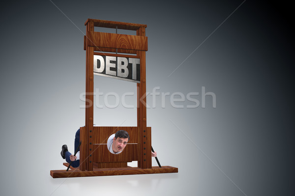 Businessman in heavy debt business concept Stock photo © Elnur
