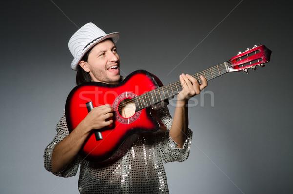 Man playing guitar during concert Stock photo © Elnur