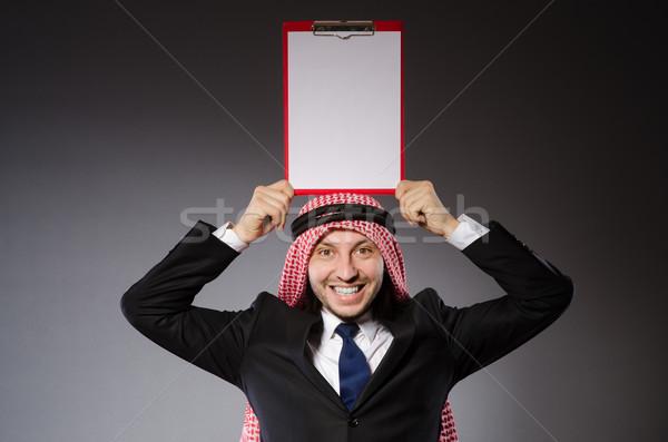 Arab man with paper binder Stock photo © Elnur