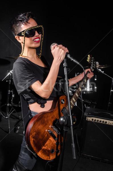 Jeune femme jouer guitare concert musique fête Photo stock © Elnur