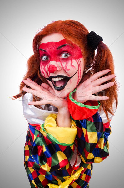 Clown in the costume isolated on white Stock photo © Elnur