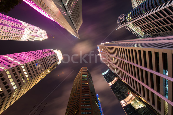 Stock photo: Skysrapers in Singapore during night hours